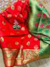 Red colored Soft banarasi silk saree with woven design