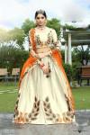Orange color satin Woven Design Lehenga