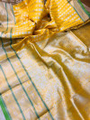 Yellow lichi soft silk saree with zari weaving work