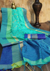 Sea green color raw silk saree with embroidered cut work