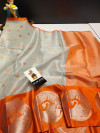 Orange and silver color tissue silk saree with zari weaving work