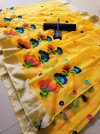 Yellow color semi linen saree with chain stitched work