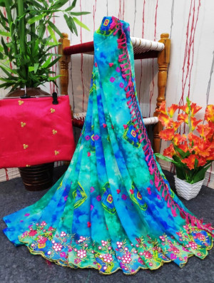 Blue color soft georgette saree with printed and foil embroidery work
