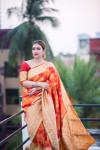 Orange color Soft Banarasi Silk Weaving checkered Work saree