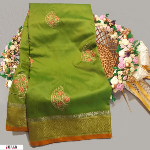 Green color Soft Raw silk embroidered work saree