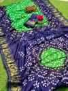 Parrot green color hand bandhej bandhani saree