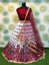 Maroon color heavy net lehenga with embroidery and moti work