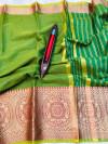 Green color kota doriya silk saree with zari weaving work