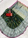 Green color banarasi silk saree with silver and golden zari work