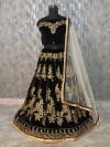 Black color tapeta velvet silk lehenga with embroidery work