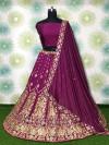 Magenta color tapeta silk lehenga with zari embroidery work
