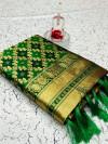 Green color banarasi weaving silk saree with beautiful tassel