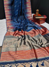 Navy blue color tussar silk weaving saree with ikkat woven border & zari woven pallu