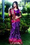 Purple color hand bandhej bandhani saree with zari weaving border