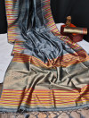 Gray color tussar silk weaving saree with ikkat woven border & zari woven pallu