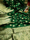 Green color soft banarasi lichi silk saree with golden zari work