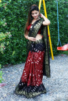 Red with black color hand bandhej bandhani saree with zari weaving border