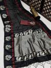 Black color soft raw silk saree with zari work