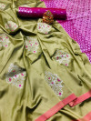 Green color lichi silk saree with zari weaving work