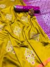 Yellow color lichi silk saree with zari weaving work