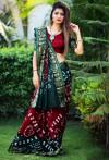 Red with green color hand bandhej bandhani saree with zari weaving border