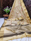Cream color assam silk saree with embroidered jal work