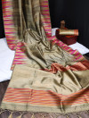 Beige color tussar silk weaving saree with ikkat woven border & zari woven pallu