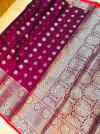 Magenta color lichi silk saree with silver zari work