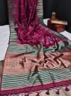 Pink color tussar silk weaving saree with ikkat woven border & zari woven pallu