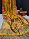 Yellow color tussar silk weaving saree with ikkat woven border & zari woven pallu