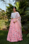 Pink color silk crepe lehenga with printed and thread embroidered work