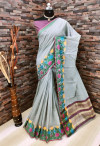 Gray color linen silk saree with flowery weaving border