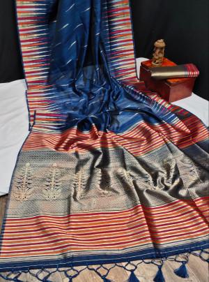 Navy blue color tussar silk weaving saree with ikkat woven border & zari woven pallu
