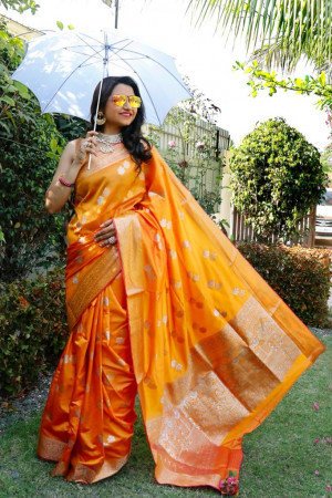 Orange color soft lichi silk saree with silver and golden zari weaving work