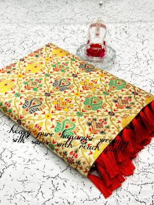 Off white color heavy banarasi weaving silk saree with beautiful tassel