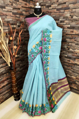 Sea green color soft linen silk saree with woven work