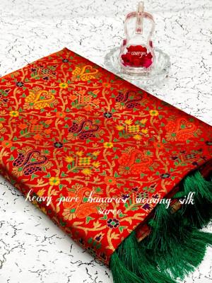 Red color heavy banarasi weaving silk saree with beautiful tassel