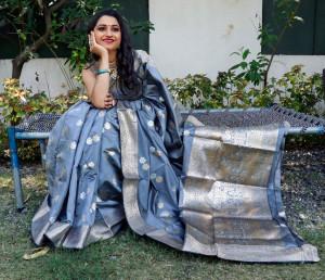 Gray color soft lichi silk saree with silver and golden zari weaving work