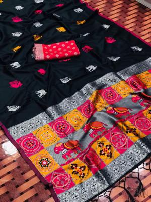 Black color lichi silk saree with silver zari weaving work