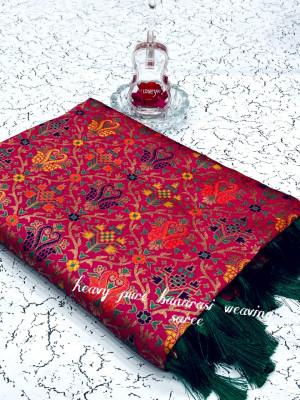 Pink color heavy banarasi weaving silk saree with beautiful tassel