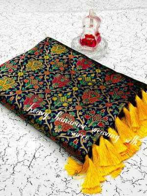 Navy blue color heavy banarasi weaving silk saree with beautiful tassel