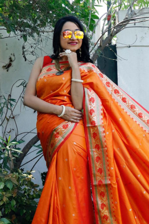 Orange color Soft banarasi silk saree with golden zari jacquard weaving work