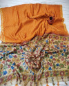 Orange color soft linen saree with traditional print work