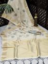 Cream color soft tissue linen silk saree with zari woven butti