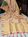 Peach color soft tissue linen silk saree with zari woven butti