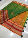 Green color soft kota cotton saree with jacquard border