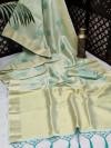 Sea green color soft tissue linen silk saree with zari woven butti
