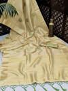 Yellow color soft tissue linen silk saree with zari woven butti
