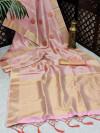 Pink color soft tissue linen silk saree with zari woven butti