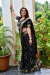 Black color pure bandhej silk saree with zari weaving border